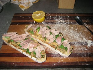 Duck and stuffing sandwiches with cilantro.